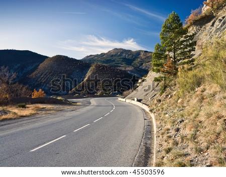 Alpine winding road - stock photo