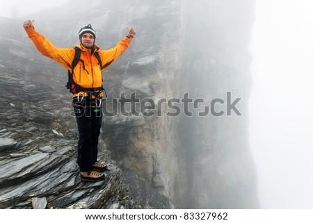 Alpinist climbing Eiger Peak, Berner Oberland, Switzerland - UNESCO Heritage - stock photo