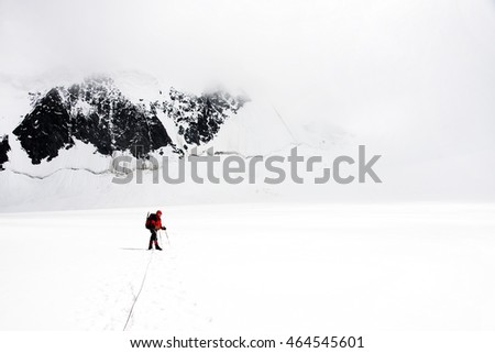 Alpinist traversing Mensu Glacier in Altai Mountains, Russian Federation
