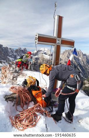 Alpinists celebrating a successfull climb - stock photo