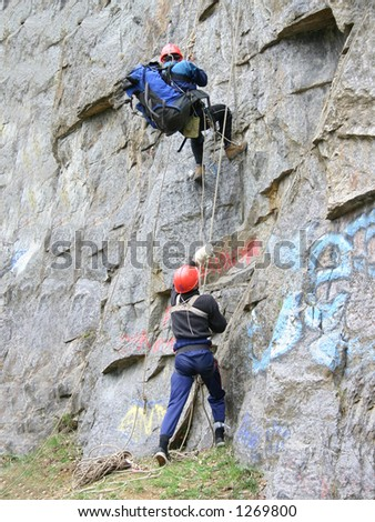 Alpinists climb on a mountain