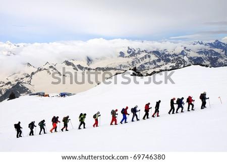 Alpinists climbing Elbrus - stock photo