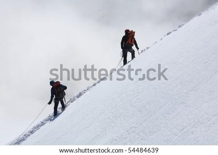 Alpinists climbing Mont Blanc - stock photo