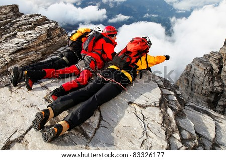 Alpinists contemplating the abyss - stock photo