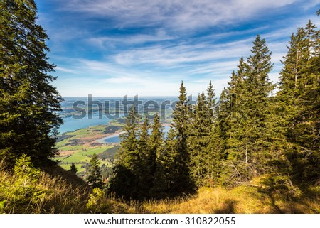 Alps and lakes in a summer day in Germany. Taken from the hill next to  Neuschwanstein castle - stock photo