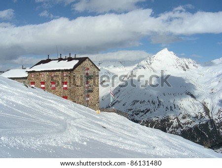 Alps cottage in winter - stock photo