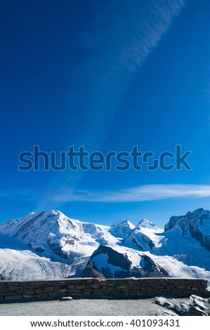 Alps mountain with snow and clear blue sky with copy space