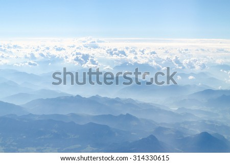 alps mountains the plain view from top - stock photo