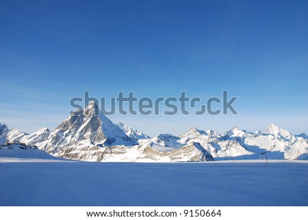 Alps panorama : blue snow and blue sky