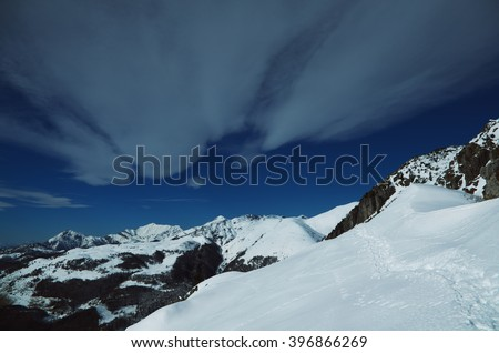 Alps -  Wonerful view of snowy mountains and blue sky with clouds. - stock photo