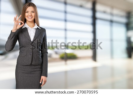 Alright. Businesswoman with big 3d chart showing ok gesture - stock photo
