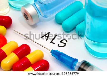 ALS - diagnosis written on a white piece of paper. Syringe and vaccine with drugs. - stock photo