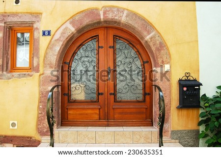 ALSACE, FRANCE - MAY 19: Entrance door on May 19, 2014 in Alsace, France. Alsace is famous for its picturesque villages, vineyards, mountains and lakes.