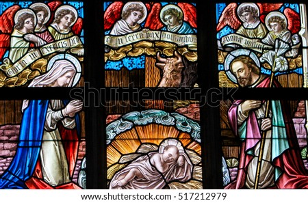 ALSEMBERG, BELGIUM - APRIL 3, 2008: Stained Glass window depicting a Nativity Scene at Christmas in the Church of Alsemberg, Belgium.