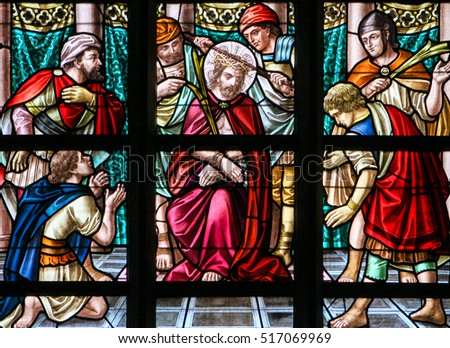 ALSEMBERG, BELGIUM - APRIL 3, 2008: Stained Glass window depicting the Torture of Jesus on Good Friday in the Church of Alsemberg, Belgium.