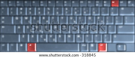 Alt, Ctrl, and Del keys of a computer keyboard shown clear and in red, while the rest of the keyboard is blurry and blueish