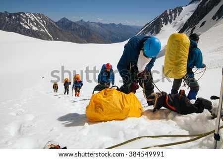 Altai, Russia - July 11, 2014: Climbers at the mountain summit in on the way to the top of Beluha