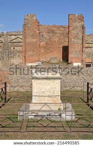 Altar in Temple of Vespasian, Pompeii, Italy. Behind the altar is the eastern wall with cella and podium. - stock photo
