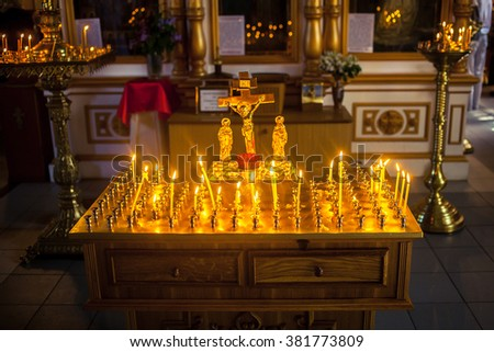 altar with cross and candles  in the Christian Church - stock photo
