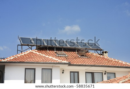 ALTERNATIVE ENERGY AT WORK - solar panels used to heat water - stock photo