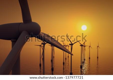 Alternative energy- close up of floating wind farm turbine at sunset. - stock photo