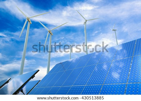 alternative energy concept with 3d rendering wind turbines and solar panels - stock photo