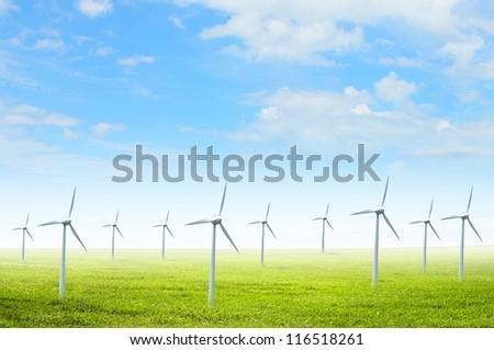 Alternative energy. Group of energy-producing windmills. Concept - stock photo