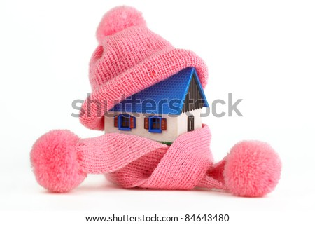 Alternative Energy Ideas, House with Purple Knitted Cap on a roof - stock photo