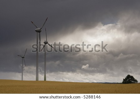 Alternative energy. Modern wind turbines creating renewable energy. - stock photo