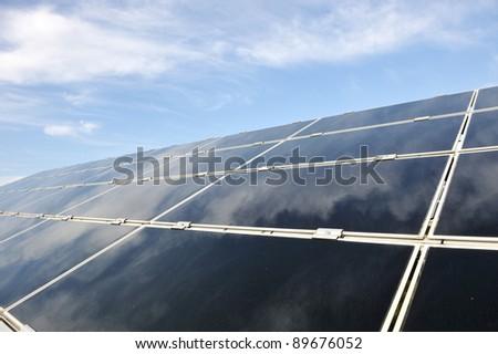 Alternative energy photovoltaic solar panels against blue sky - stock photo