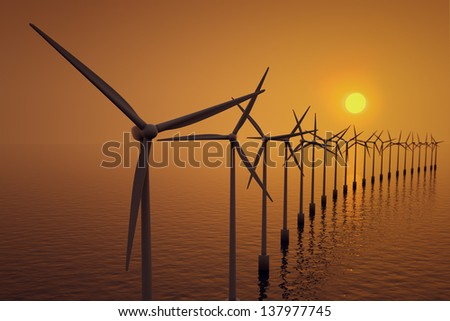 Alternative energy- row of floating wind turbines during sunset. - stock photo