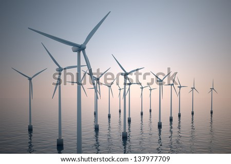 Alternative energy- shot of floating wind turbine farm during foggy morning. - stock photo
