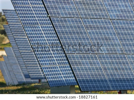 Alternative energy; Solar panels aligned and faced to the sunlight.