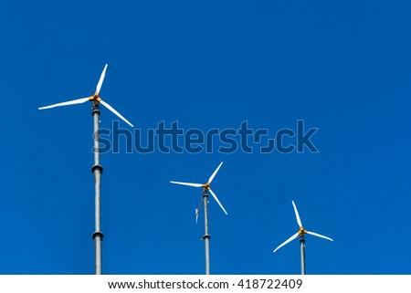 Alternative energy, Wind turbine farm for electric power production. - stock photo