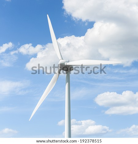 Alternative Energy Wind turbine winpower on blue sky with clouds