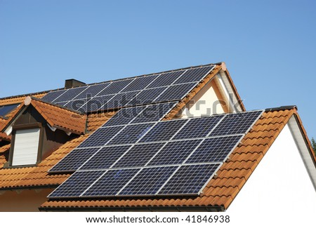 Alternative energy with solar panels - stock photo