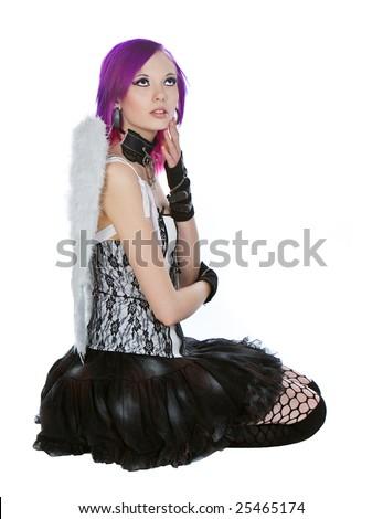 Alternative Girl in Angel Wings against White Background - stock photo