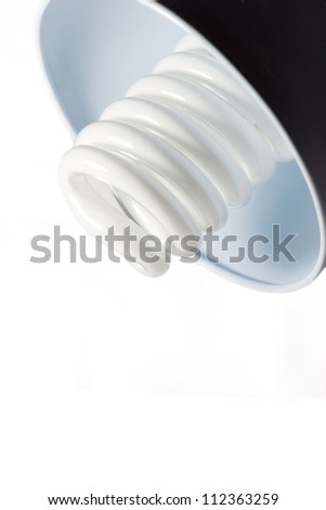 Alternative low power compact glass frosted light bulb. efficient consumption concept - stock photo
