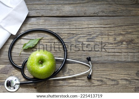 Alternative medicine stethoscope and green symbol background - stock photo