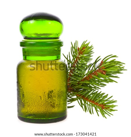 alternative medicine - the oil from pine needles in a green bottle, and a coniferous branch  isolated on white background - stock photo