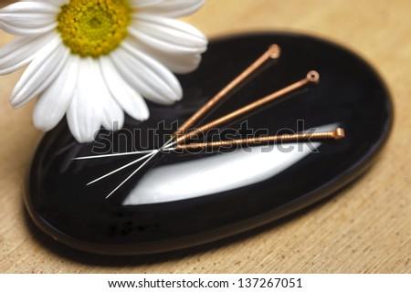 alternative medicine with acupuncture - stock photo