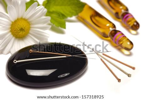 alternative medicine with acupuncture needles - stock photo