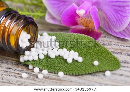 alternative medicine with herbal pills - stock photo