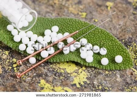 alternative medicine with homeopathic globules - stock photo