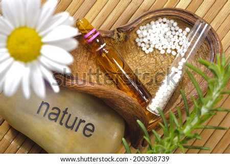 alternative medicine with homeopathic herbal pills - stock photo