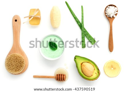 Alternative skin care and homemade scrubs with natural ,sea salt ,honey, aloe vera,lemon and mint set up on top white tabale background. - stock photo