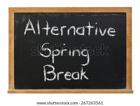 Alternative Spring Break written in white chalk on a black chalkboard isolated on white - stock photo