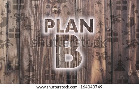 alternative wooden plan b label on wood with burned in christmas symbols such as snowflakes presents and stars - stock photo