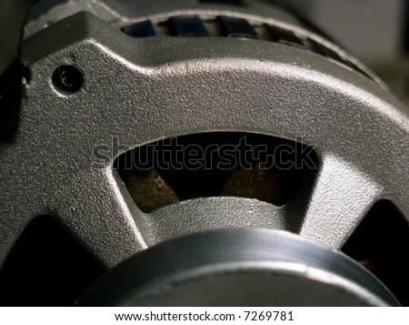 Alternator charges electrical battery to run electronics in modern cars - stock photo
