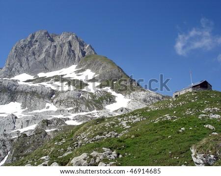Altmann Summit And Zwinglipass Mountain Hut In Apenzell Alps, Alpstein Massif, Switzerland - stock photo
